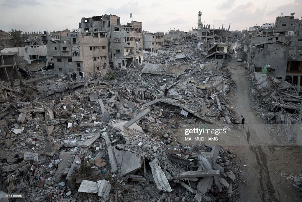 Palestinians walk through rubble of destroyed homes and buildings from the 50day conflict between Hamas militants and Israel in Shejaiya...