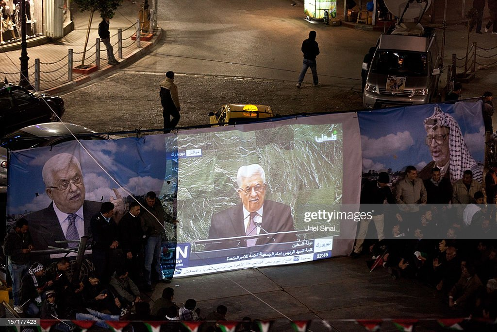 Palestinians watch on a big screen Palestinian President Mahmoud Abbas speak at the U.N. General Assembly on November 29, 2012 in Ramallah, the West Bank. The General Assembly later voted 138-9, with 41 abstentions, to upgrade the Palestinian Authority's status to non-member observer state. Among nations voting no were the U.S., Israel and Canada.