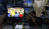 Palestinians watch the opening match of the 2014 FIFA World Cup between Brazil and Croatia being played at the Corinthians Arena in Sao Paulo Brazil...