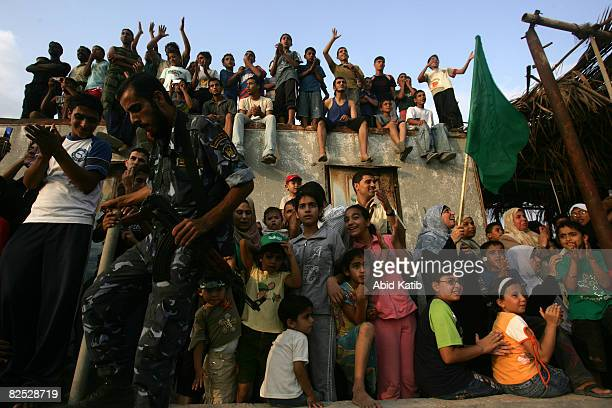 Palestinians watch two boats from the Free Gaza protest group arrives from Cyprus as they arrive August 23 2008 in Gaza City Gaza Two boats carrying...