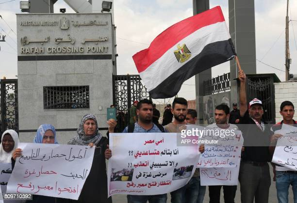 Palestinians wave the Egyptian flag and hold posters as they attend a rally at the Rafah border crossing between Egypt and Gaza calling on Egypt to...
