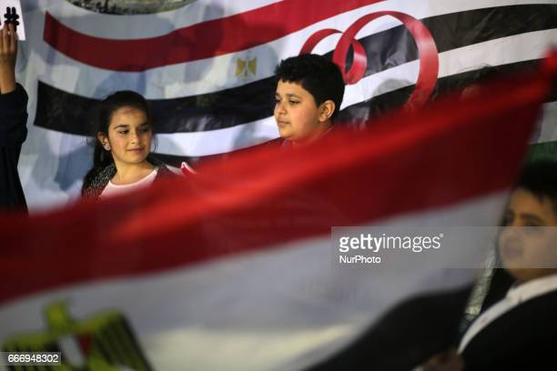 Palestinians wave the Palestinian and Egyptian flag during a gathering in Gaza City on April 10 2017 in solidarity with the victims of the twin...