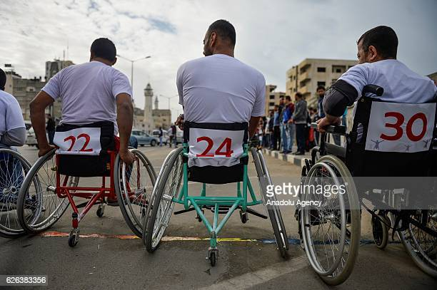Palestinians who have been wounded during Israeli attacks compete during the wheelchair marathon organised by Al Selame association in Gaza City Gaza...