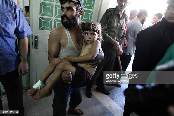 Palestinians who injured during an attack on the schools of UNRWA in Gaza are taken to Kemal Advan hospital in Gaza City Gaza on July 24 2014 Seven...