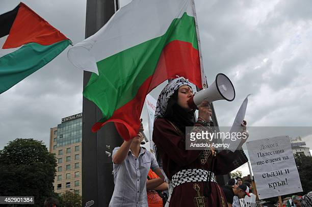 Palestinians who live in Bulgaria hold Palestine flags during a protest against the Israeli military operations on Gaza in Sophia Bulgaria on July 29...