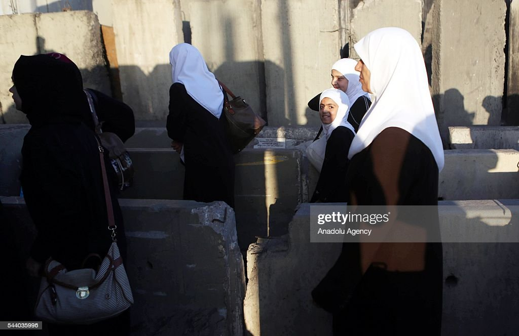 Palestinians who want to visit Al-Aqsa Mosque on the Islamic holy fasting month of Ramadan, enter Jerusalem from the Kalandia checkpoint with the Israeli entry permit, in Ramallah, West Bank for the first Friday on July 1, 2016. Palestinian women, children under 12 and men older than 45 are allowed to enter the compound.