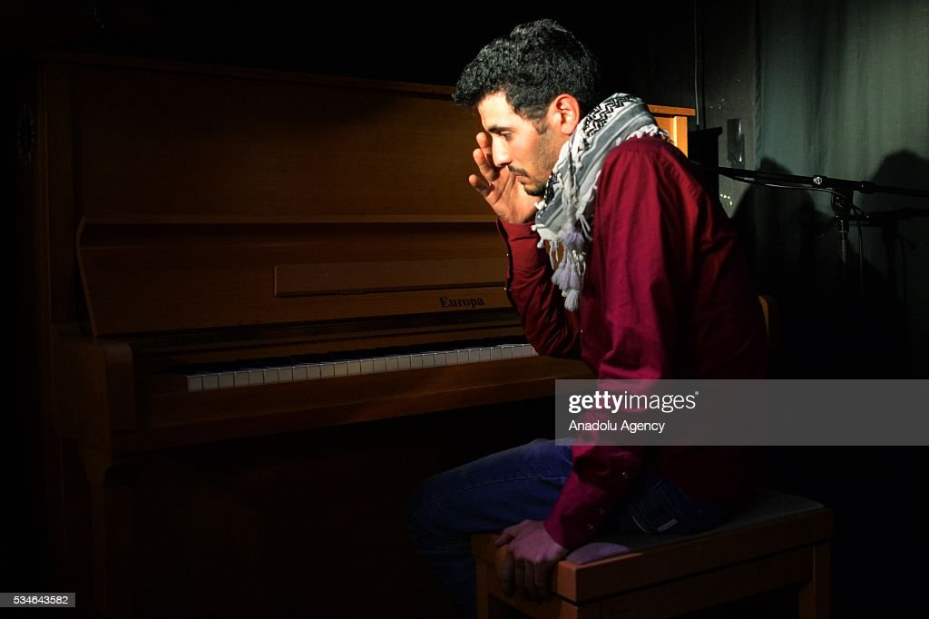 Palestinian-Syrian refugee Ayham Ahmad, also known as the pianist of Yarmouk performs during a concert at Artliners Concert Hall in Berlin, Germany on May 25, 2016.