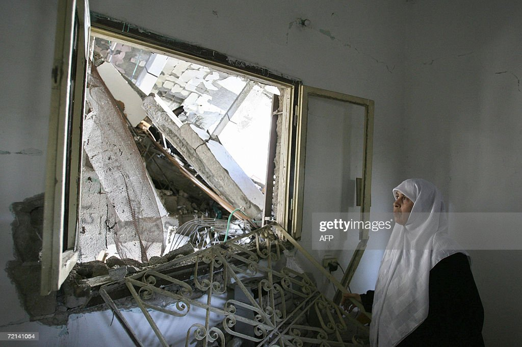 Palimentarian Mariam Farhat inspects at her destroyed home following an Israeli missile attack in Gaza City 11 October 2006. Farhat a mother of six lost three of her militant sons to suicide bombings and Israeli military attacks. Two Palestinian men were killed by Israeli fire in the northern Gaza Strip and the occupied West Bank, medical and security officials said. The deaths bring to 5,414 the number of people killed since the Palestinian uprising broke out in September 2000, the vast majority of them Palestinians, according to an AFP count.