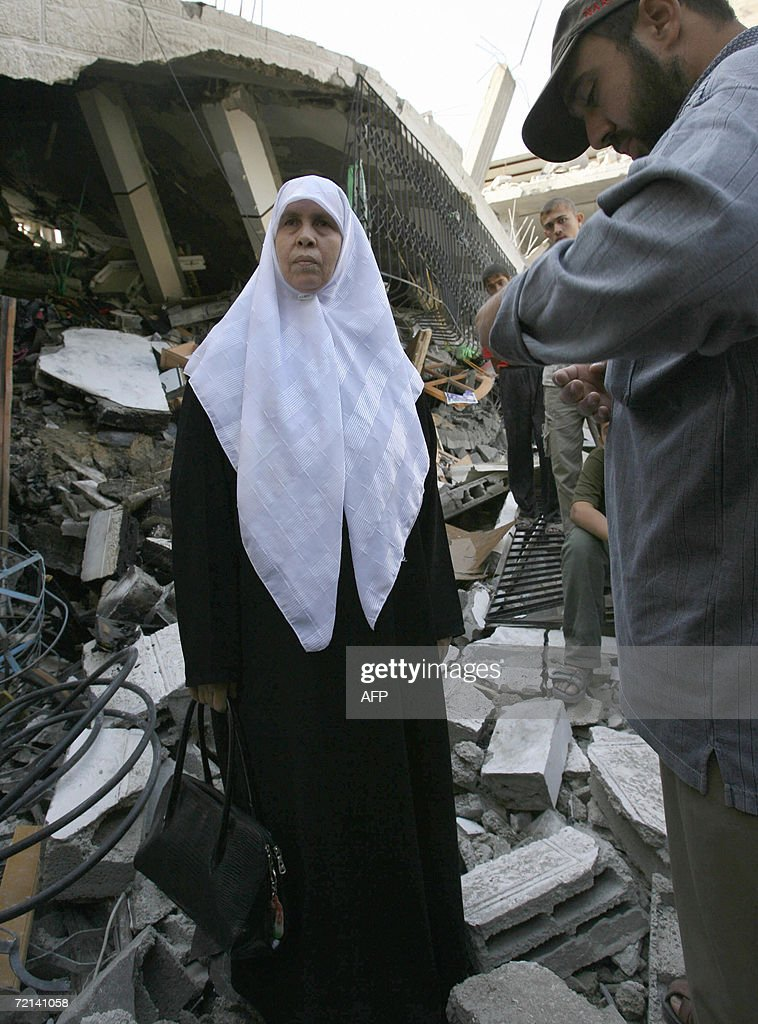 Palimentarian Mariam Farhat inspects at her destroyed home following an Israeli missile attack in Gaza City 11 October 2006. Farhat a mother of six lost three of her militant sons to suicide bombings and Israeli military attacks. Two Palestinian men were killed by Israeli fire in the northern Gaza Strip and the occupied West Bank, medical and security officials said. The deaths bring to 5,414 the number of people killed since the Palestinian uprising broke out in September 2000, the vast majority of them Palestinians, according to an AFP count. AFP PHOTO / MOHAMMED ABED