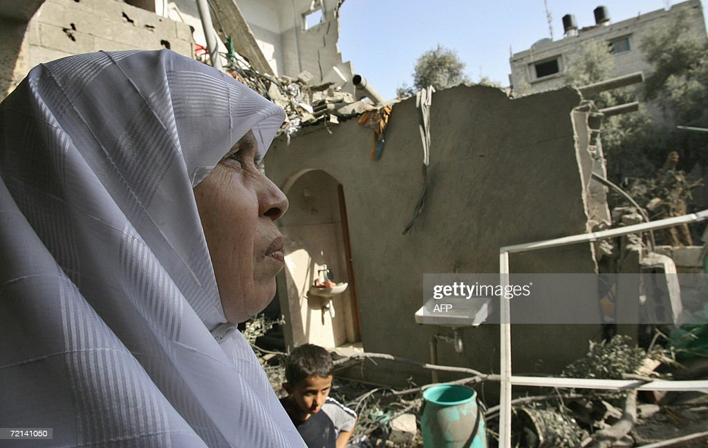 Palimentarian Mariam Farhat looks at her destroyed home following an Israeli missile attack in Gaza City 11 October 2006. Farhat a mother of six lost three of her militant sons to suicide bombings and Israeli military attacks. Two Palestinian men were killed by Israeli fire in the northern Gaza Strip and the occupied West Bank, medical and security officials said. The deaths bring to 5,414 the number of people killed since the Palestinian uprising broke out in September 2000, the vast majority of them Palestinians, according to an AFP count. AFP PHOTO / MOHAMMED ABED