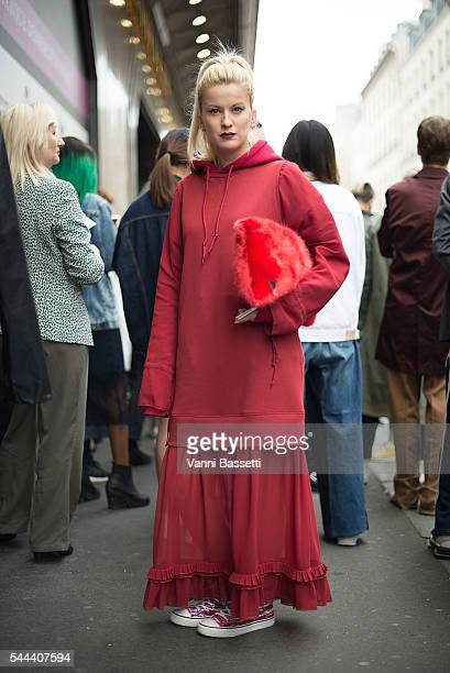 Palina Pralina poses wearing Maison Martin Margiela dress and Isabel Marant shoes before the Vetements show at Galeries Lafayette during Paris...