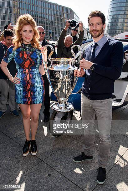 Palina Rojinski and Arne Friedrich pose with the cup at Potsdamer Platz during the UEFA Champions League Trophy Tour Berlin on April 29 2015 in...