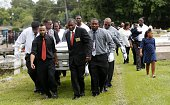 Pall bearers carry the casket of Alton Sterling to his gravesite at the Mount Pilgrim Benevolent Society Cemetery July 15 2016 in Baton Rouge...