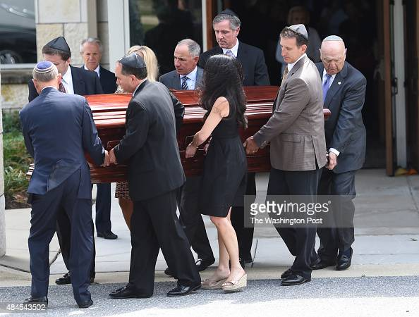 Pall bearers carry the casket to the hearse following the funeral services for Lenny Robinson better known as the Route 29 Batman had for years...