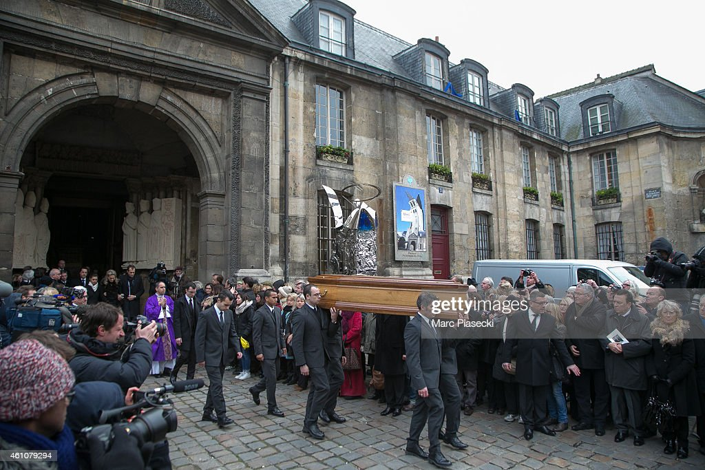 Pall bearers carry the coffin during the funeral of journalist Jacques Chancel at Saint-Germain-des-Pres church on January 6, 2015 in Paris, France.