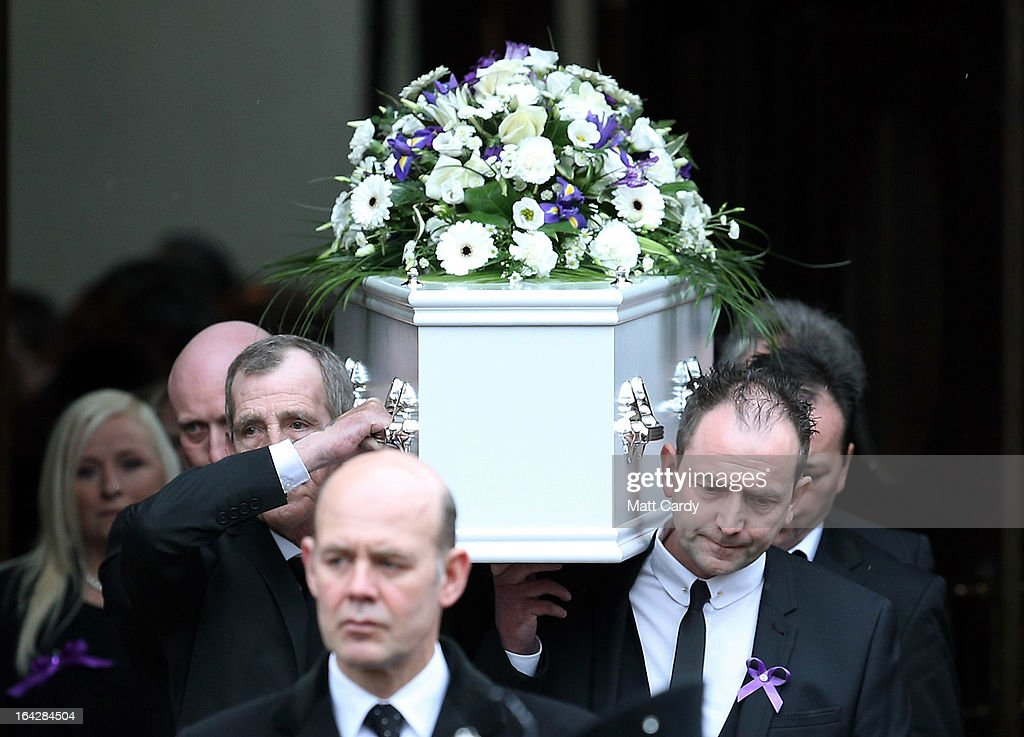 Pall bearers carry the coffin of Christina Edkins from the funeral service at St Phillips Cathedral on March 22, 2013 in Birmingham, England. Hundreds of people attended the service for the teenager, who was stabbed to death on a bus in Birmingham. Leasowes High School, in Halesowen, where the 16-year-old was a pupil, was closed today to allow children and staff to join her family at the service
