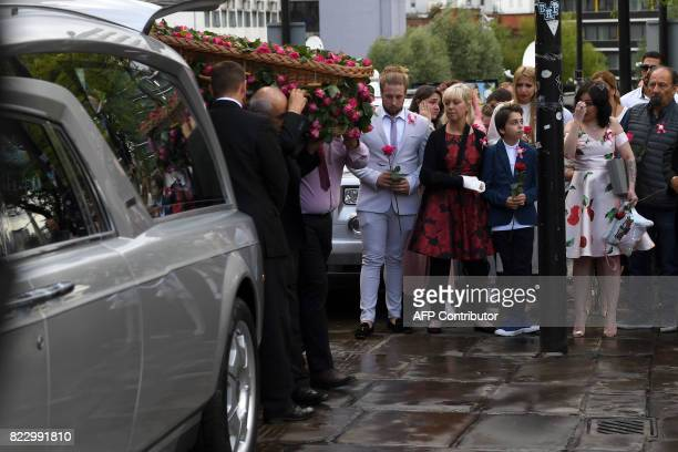 Pall bearers carry the coffin of Manchester Arena bomb victim SaffieRose Roussos as her mother Lisa brother Alexander and family members look on...