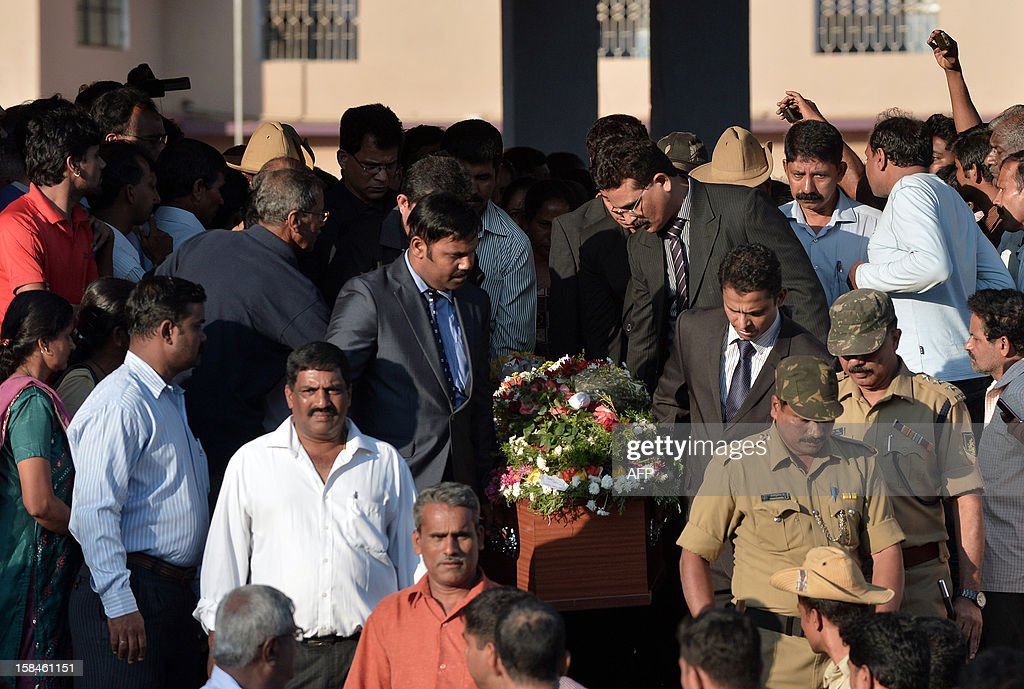 Pall bearers carry the coffin of nurse Jacintha Saldanha during her funeral at The Shirve Church cemetary near Mangalore on December 17, 2012. About 2,000 mourners have packed a Catholic church in southwest India for the funeral of the nurse who was found hanged after taking a hoax call to the hospital treating Prince William's wife. Indian-born Jacintha Saldanha, 46, apparently committed suicide after answering the telephone call from Australian radio DJs to the hospital where the pregnant Duchess of Cambridge was admitted with acute morning sickness. AFP PHOTO/Manjunath KIRAN