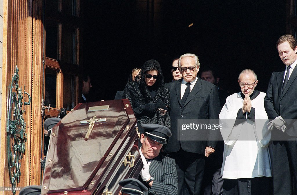 Pall bearers carry the coffin of Stefano Casiraghi as Prince Rainier III comforts Princess Caroline leaving the Monaco cathedral 06 October 1990 after the funeral ceremony. Stefano Casiraghi, Princess Caroline's husband, was killed in an offshore powerboat racing accident off the coast of Monaco 03 October 1990 while defending his World Off-shore title.
