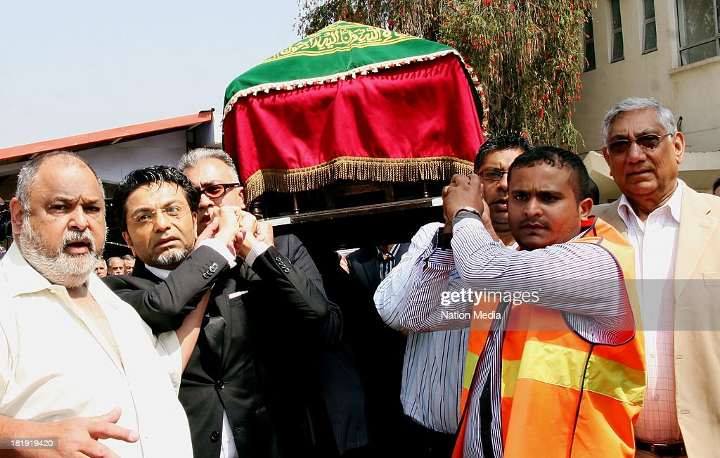 Pall bearers carry the coffin of the East Fm Radio Presenter Ruhilla Adatia on September 26 2013 at the Agan Pavillion hall in Nairobi Kenya She was...