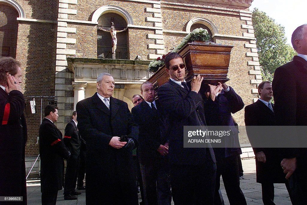 Pall bearers leave St. Matthew's Church in Bethnal Green carrying the coffin of Reggie Kray in London Tuesday 11 October 2000. Kray, who died of cancer 10 days ago, was one of Britain's most feared gangsters who held a mafia-like grip on London's East End during the 1960's. Reggie Kray and his twin brother Ronnie were convicted of murder and sentenced to life in prison in 1969.