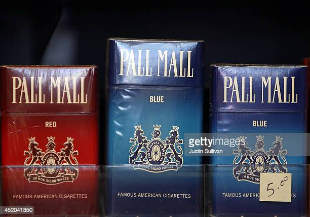 Pall Mall cigarettes manufactured by Reynolds Amercian are displayed at a tobacco shop on July 11 2014 in San Francisco California Tobacco giant...