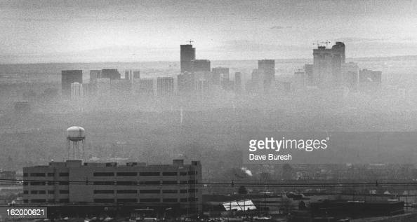 Pall of Pollution The Denver area's infamous brown cloud hovers over downtown Thursday in this view from the Warren Occupational Technical Center on...