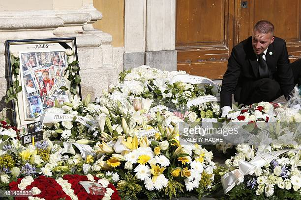 A pallbearer places wreaths of flowers after the funeral ceremony for French Formula One driver Jules Bianchi at the Cathedrale Sainte Reparate in...