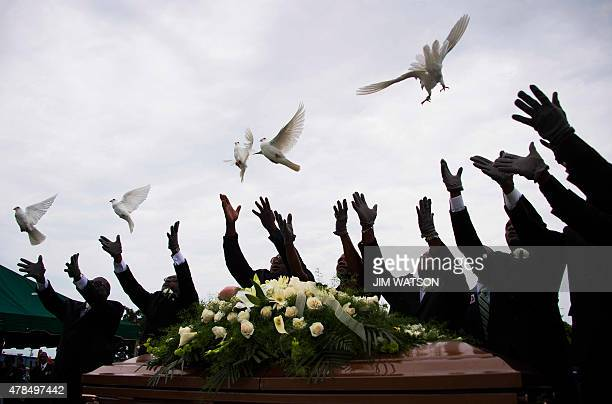 Pallbearer release doves over the casket holding Emanuel AME Church shooting victim Ethel Lance during her burial at the Emanuel AME Church Cemetery...