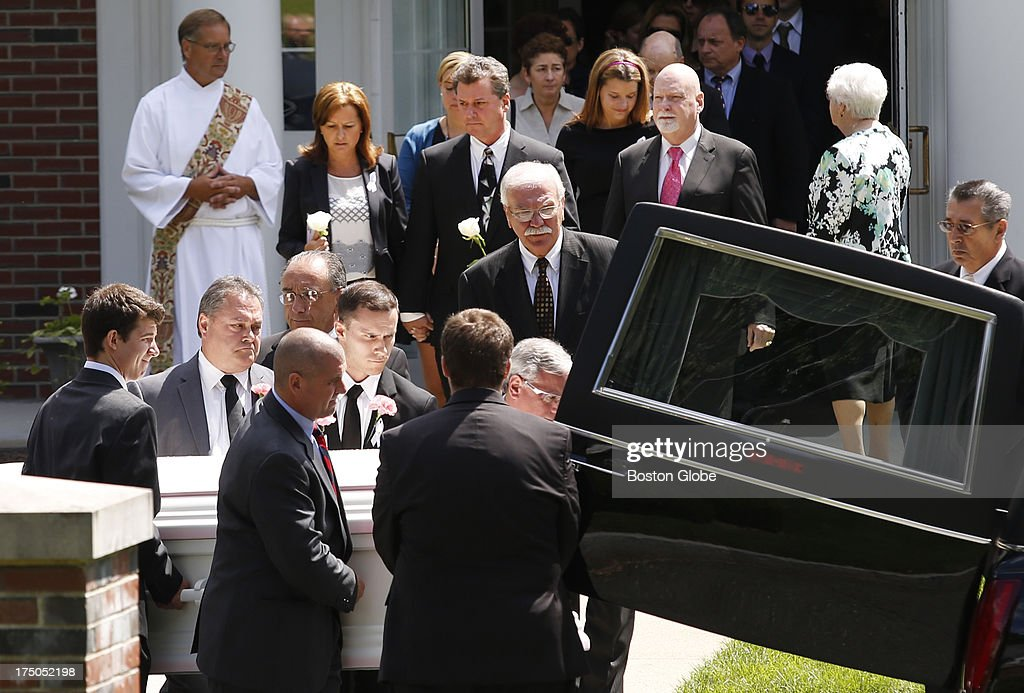 Pallbearers carry Amy Lord's casket as mourners file out of St. Cecilia's Church behind them following the funeral mass for Amy Lord in Wilbraham, Mass., July 30, 2013.