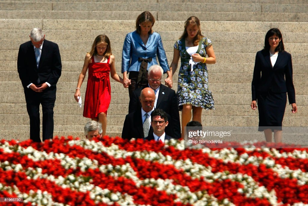 Pallbearers carry former White House Press Secretary Tony Snow's remains out of the Basilica of the National Shrine of the Immaculate Conception followed by his wife, Jill (C-in blue), and their two daughters after his funeral July 17, 2008 in Washington, DC. U.S. President George W. Bush and first lady Laura Bush attended the funeral for Snow, who died July 12 after a long battle with colon cancer.