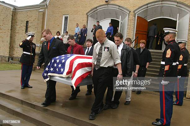 Pallbearers carry the body of Brandon Smith out of a church to be buried PFC Brandon Smith a 20year old Marine was killed on his first day on...