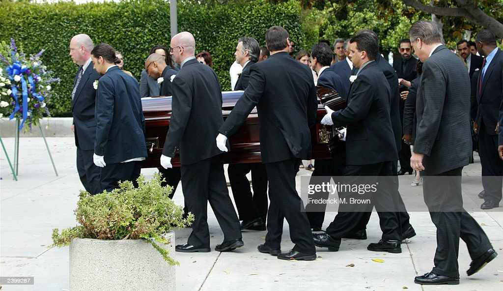 Pallbearers carry the body of Gregory Hines to the memorial service for Hines at Saint Monica's Catholic Church on August 13, 2003 in Santa Monica, California.