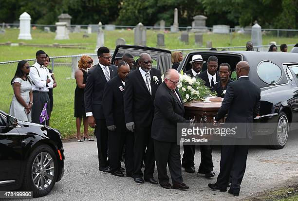 Pallbearers carry the casket of Ethel Lance as she is buried at the AME Church cemetery she was one of nine victims of a mass shooting at the Emanuel...