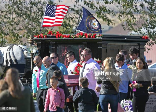 Pallbearers carry the casket of Heather Lorraine Alvarado from a horse drawn hurst at the cemetery on October 13 2017 in Enoch Utah Alvarado was a 35...