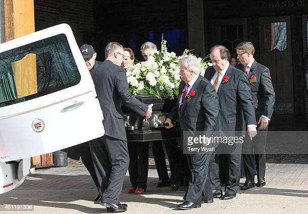 Pallbearers carry the casket of Little Jimmy Dickins to a white hearse during his Public Celebration of Life at The Grand Ole Opry on January 8 2015...