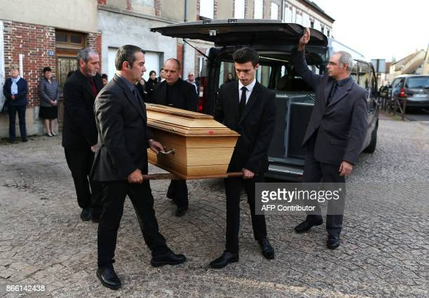Pallbearers carry the coffin during the funeral of the French actress Danielle Darrieux in BoisleRoi northwestern France on October 25 2017 / AFP...
