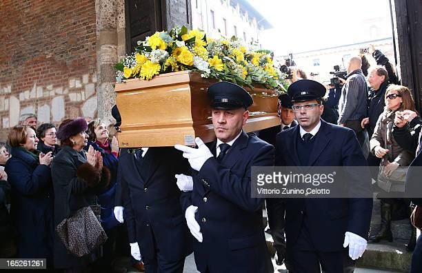 Pallbearers carry the coffin of Enzo Jannacci during his funeral at Basilica di Sant'Ambrogio on April 2 2013 in Milan Italy