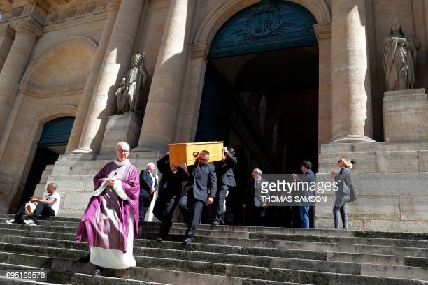 Pallbearers carry the coffin of French actor JeanMarc Thibault during his funeral at the SaintRoch Church in Paris on June 12 2017 / AFP PHOTO /...