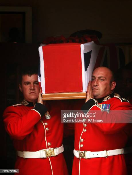 Pallbearers carry the coffin of Lance Sergeant Dale McCallum of 1st Battalion Scots Guards out of the New Testament Church of God in Willesden north...