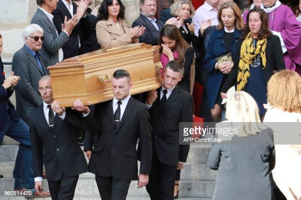 Pallbearers carry the coffin of late French actor Jean Rochefort followed by his widow Francoise Vidal and two of his daughters Clemence and Louise...