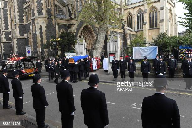 Pallbearers carry the coffin of PC Keith Palmer into Southwark Cathedral during his funeral service on April 10 2017 in London United Kingdom A Full...
