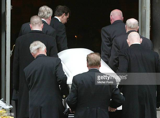 Pallbearers carry the coffin of slain Dutch politician Pim Fortuyn into the Laurentius and Elisabeth Cathedral for his funeral service May 10 2002 in...