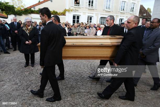 Pallbearers carry the coffin of the late French actress Danielle Darrieux during her funeral service in BoisleRoi northwestern France on October 25...
