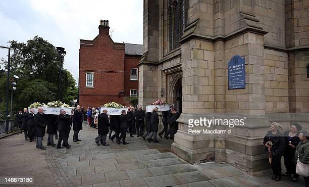 Pallbearers carry the coffins of the Philpott children to St Mary's Church on June 22 2012 in Derby England Hundreds of people gathered for the...