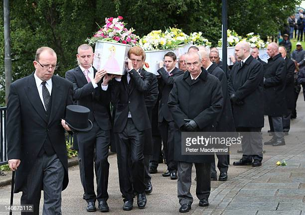 Pallbearers carry the coffins of the six Philpott children to St Mary's Church on June 22 2012 in Derby England Hundreds of people gathered for the...