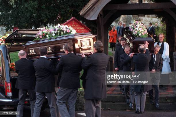 Pallbearers carry the cofins of George and Ivy Wigham into All Soul's Church in Crockenhill Swanley Kent today Mr and Mrs Wigham were among 68 people...