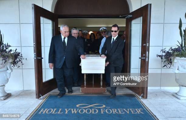 Pallbearers carry the pine box coffin of Mitchell Flint on September 19 2017 at the Hollywood Forever cemetery in Hollywood California during a...