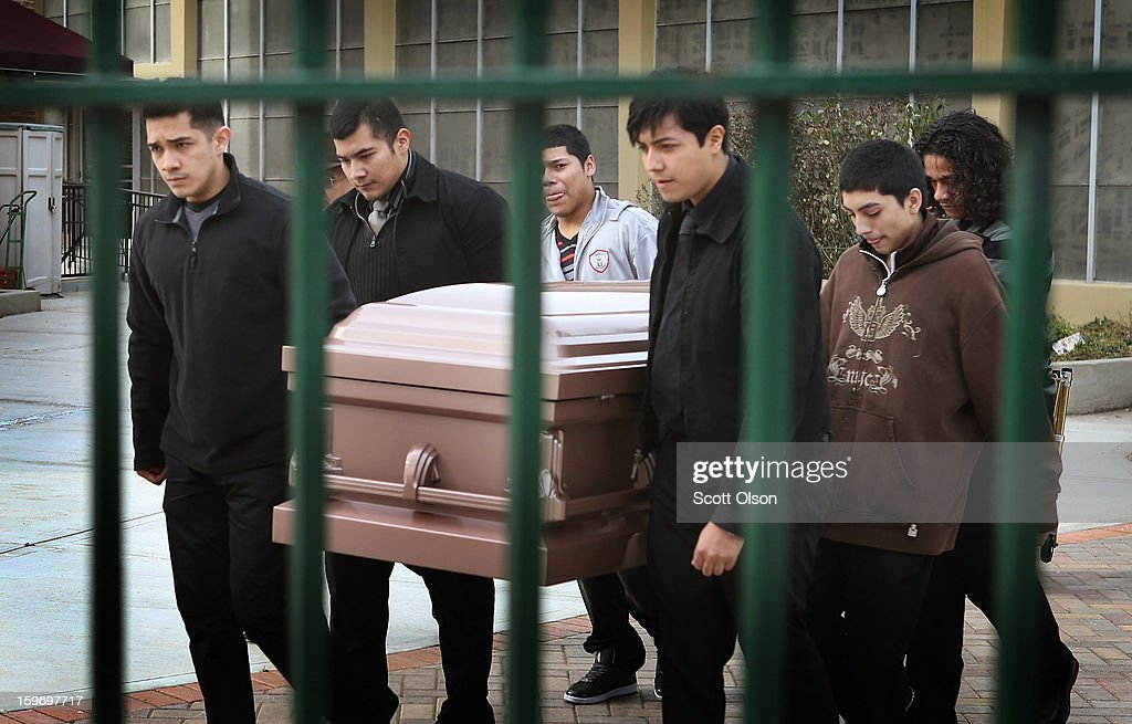 Pallbearers carry the remains of Rey Dorantes, 14, following a funeral mass at St. Mark Church on January 18, 2013 in Chicago, Illinois. Dorantes died after being shot six times while he was sitting on the front porch of his home while talking on the phone on January 11. Dorantes's murder was the 21st homicide recorded in Chicago for 2013, a city which saw more than 500 homicides in 2012.