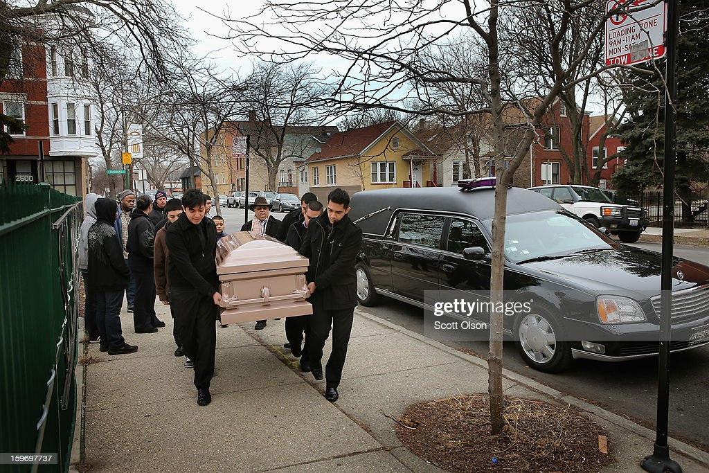 Pallbearers carry the remains of Rey Dorantes, 14, to St. Mark Church for a funeral mass on January 18, 2013 in Chicago, Illinois. Dorantes died after being shot six times while he was sitting on the front porch of his home while talking on the phone on January 11. Dorantes' murder was the 21st homicide recorded in Chicago for 2013, a city which saw more than 500 homicides in 2012.